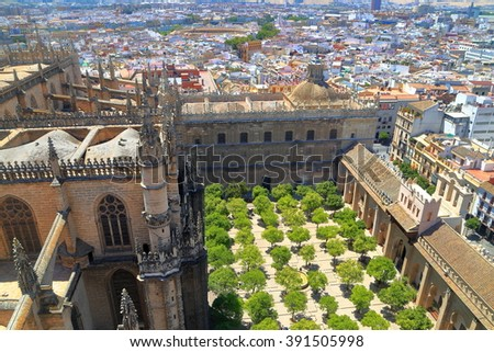 Aerial view to the orange trees in the patio of the Cathedral of Saint Mary of the See (Seville Cathedral) in Seville, Andalusia, Spain - stock photo