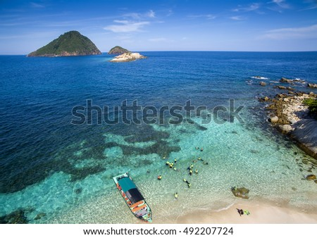 aerial view water confident grouping snokeling at perhentian island, malaysia