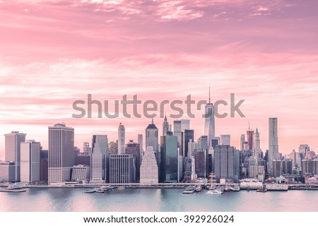 Aerial view with red filter of downtown Manhattan Skyline from Brooklyn Heights during golden hour sunset