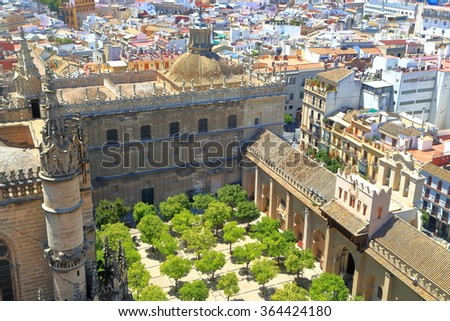 Aerial view yo the orange trees of the Cathedral of Saint Mary of the See (Seville Cathedral) in Seville, Andalusia, Spain