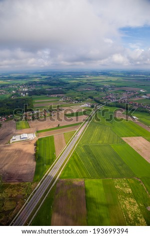 Aerial vista over farm and village