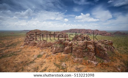 Aerials of the Bungle Bungles taken from dedicated a helicopter flight during the Wet season at much lower height than normal tourist flights showing unprecedented detail not normally seen.