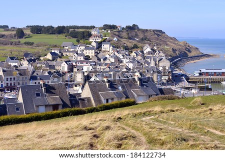Aerien view of town of Port-en-Bessin, a commune in the Calvados department in the Basse-Normandie region in northwestern France. The commune contains the two towns of Port-en-Bessin and Huppain. - stock photo
