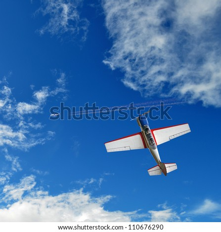 Aerobatic airplane in the blue sky - stock photo