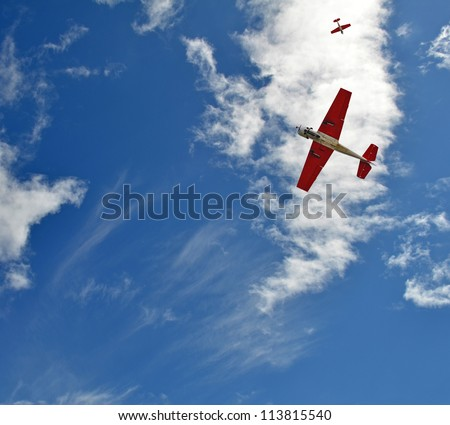 Aerobatic airplanes in the sky - stock photo