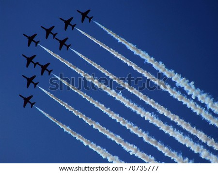 Aerobatic group formation at blue sky during Air Show 2009 in Radom, Poland - stock photo