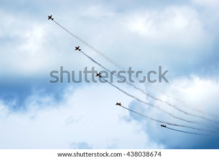 Aerobatic team performs flight at air show in New Zealand - stock photo