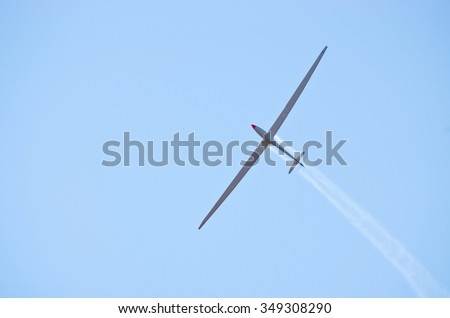 Aerobatics glider on the sky - stock photo