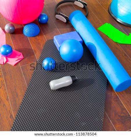 Aerobic Pilates stuff like mat balls roller magic ring rubber bands on wooden floor - stock photo