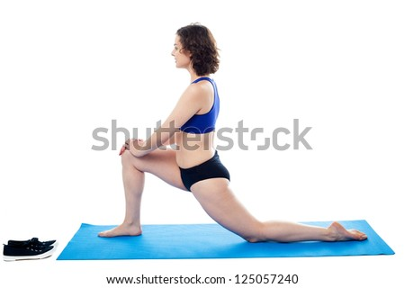 Aerobic posture of a fit young woman isolated on white background. - stock photo