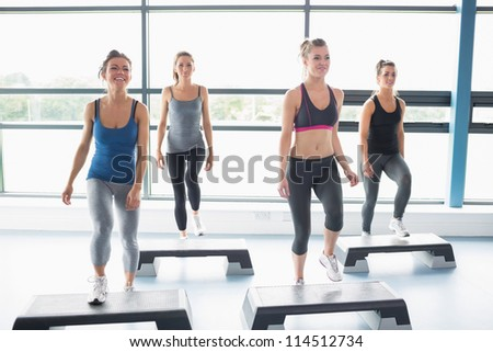 Aerobics class in gym - stock photo