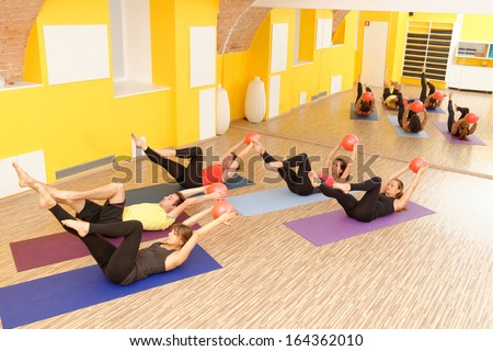 Aerobics pilates class with yoga balls in a row on fitness class - stock photo