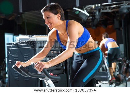 Aerobics spinning monitor trainer woman at gym at training class - stock photo