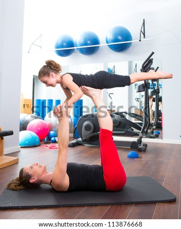 Aerobics woman personal trainer of children girl stability balance - stock photo