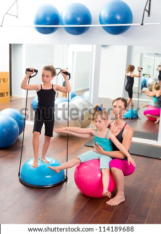Aerobics woman personal trainer of children girl with stability ball
