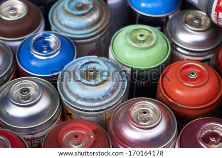 aerosol cans in different colors
