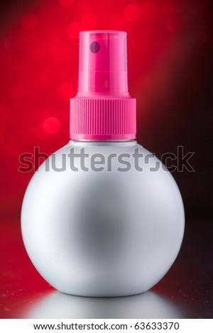 Aerosol Spray isolated on the red background - stock photo