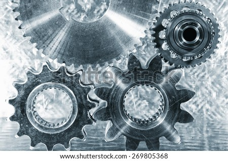 aerospace engineering cogwheels and gears,  titanium and steel parts - stock photo