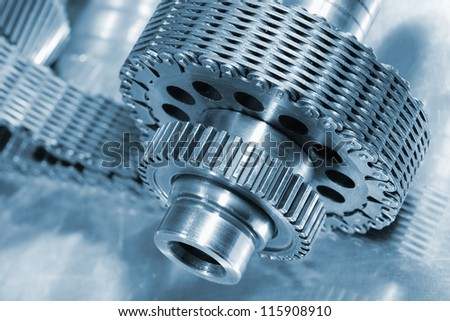 aerospace gears and chain, titanium and in a deep blue toning concept - stock photo
