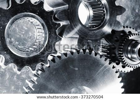aerospace titanium cogwheels and gear parts, blue toning idea - stock photo