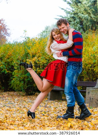 Affection and feelings. Expressing positive emotions. Friendship and love. Young couple meet at park having fun on a romantic date. Man hold woman in arms hug and play.