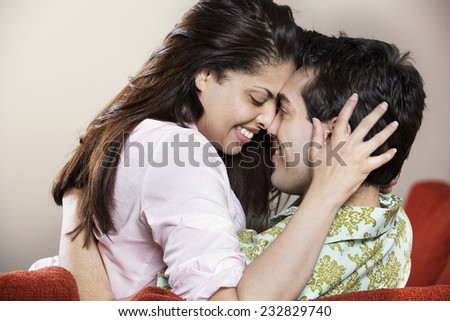 Affectionate Couple on Sofa - stock photo