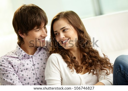 Affectionate couple spending time together at home