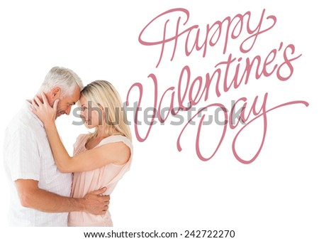 Affectionate couple standing and hugging against cute valentines message - stock photo