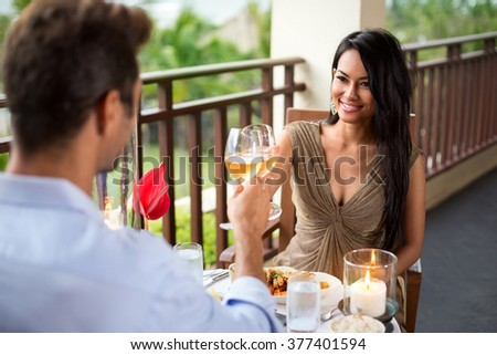 Affectionate couple toasting their love on romantic dinner  - stock photo