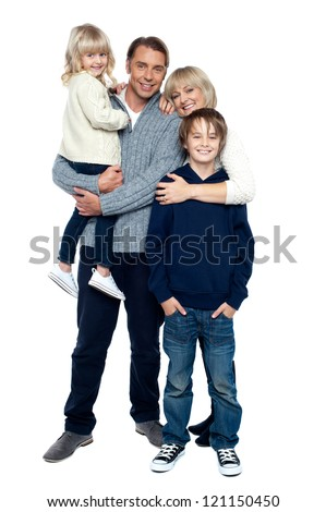 Affectionate family of four posing in winter outfits. Full length studio shot. - stock photo