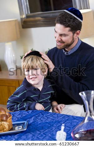 Affectionate father and 4 year old son celebrating Hanukkah - stock photo