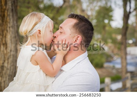 Affectionate Father Playing With Cute Baby Girl Outside at the Park. - stock photo