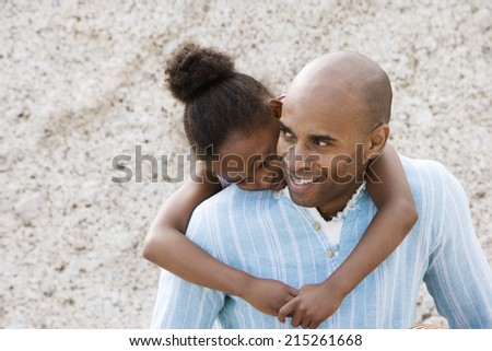 Affectionate girl embracing father, smiling, close-up - stock photo