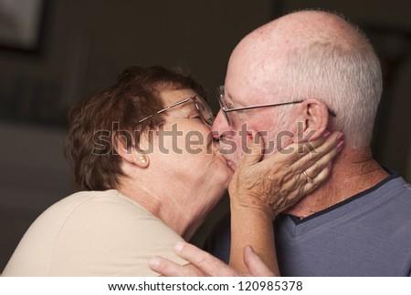 Affectionate Happy Senior Couple Kissing. - stock photo