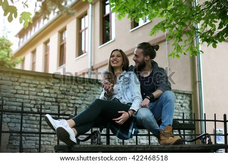 Affectionate happy young couple having fun in the city. - stock photo