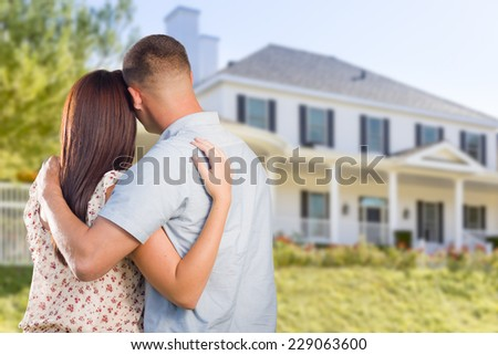 Affectionate Military Couple Looking at Nice New House. - stock photo