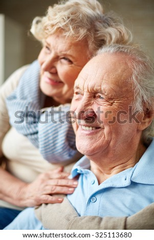 Affectionate senior man and woman - stock photo