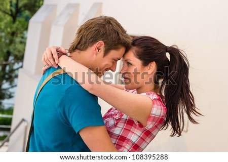 Affectionate young couple hugging looking at each other - stock photo