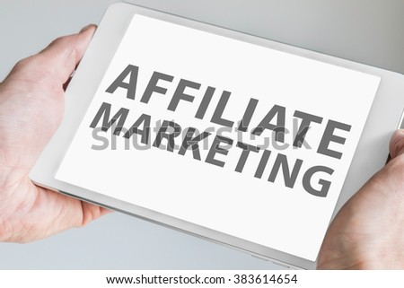 Affiliate marketing text displayed on touchscreen of modern tablet or smart device. Concept of online web marketing. - stock photo