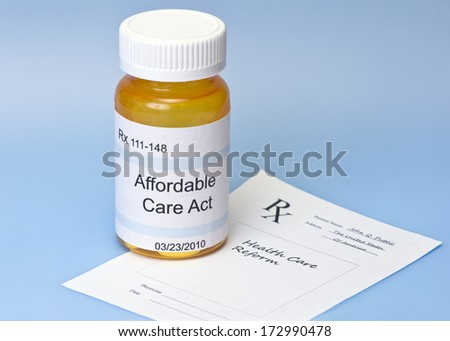 Affordable Care Act prescription bottle on blue with prescription for health care reform. - stock photo
