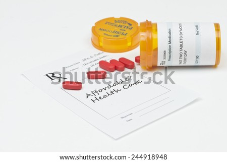 Affordable health care prescription with red pills and prescription bottle. - stock photo