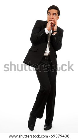 Afraid businessman showing frightening gesture and looking aside