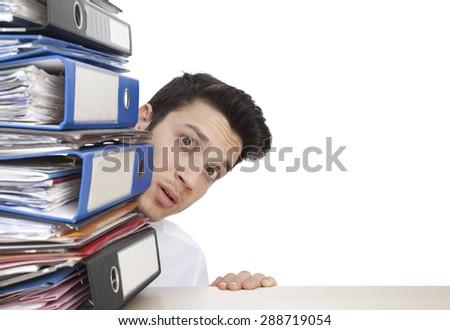 Afraid businessman with folders - stock photo