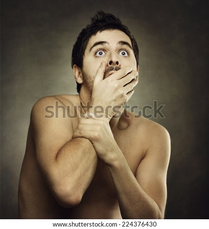 Afraid male victim human with hand covering his mouth - stock photo