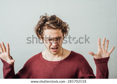 Afraid man in defense attitude gesturing stop with hands