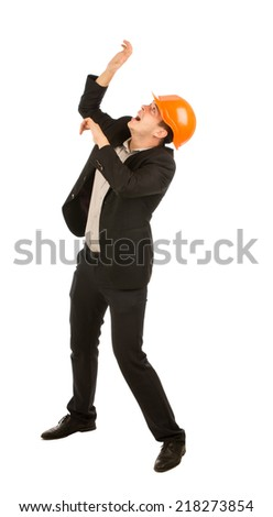 Afraid Middle Age Male Engineer Looking on Top For Falling Debris. Captured on White Background. - stock photo
