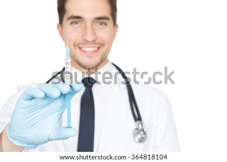 Afraid of needles? Vertical closeup shot of a male doctor holding out a syringe towards the camera  - stock photo