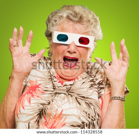 Afraid Senior Woman Wearing 3d Glasses Isolated On Green Background - stock photo