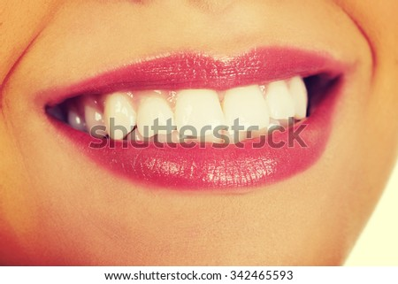Afrian woman's mouth with perfect smile.