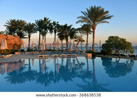 Africa, Egypt, January 12, 2016, Swimming pool with sun beds at the hotel,Africa, Egypt, January 12, 2016 - stock photo